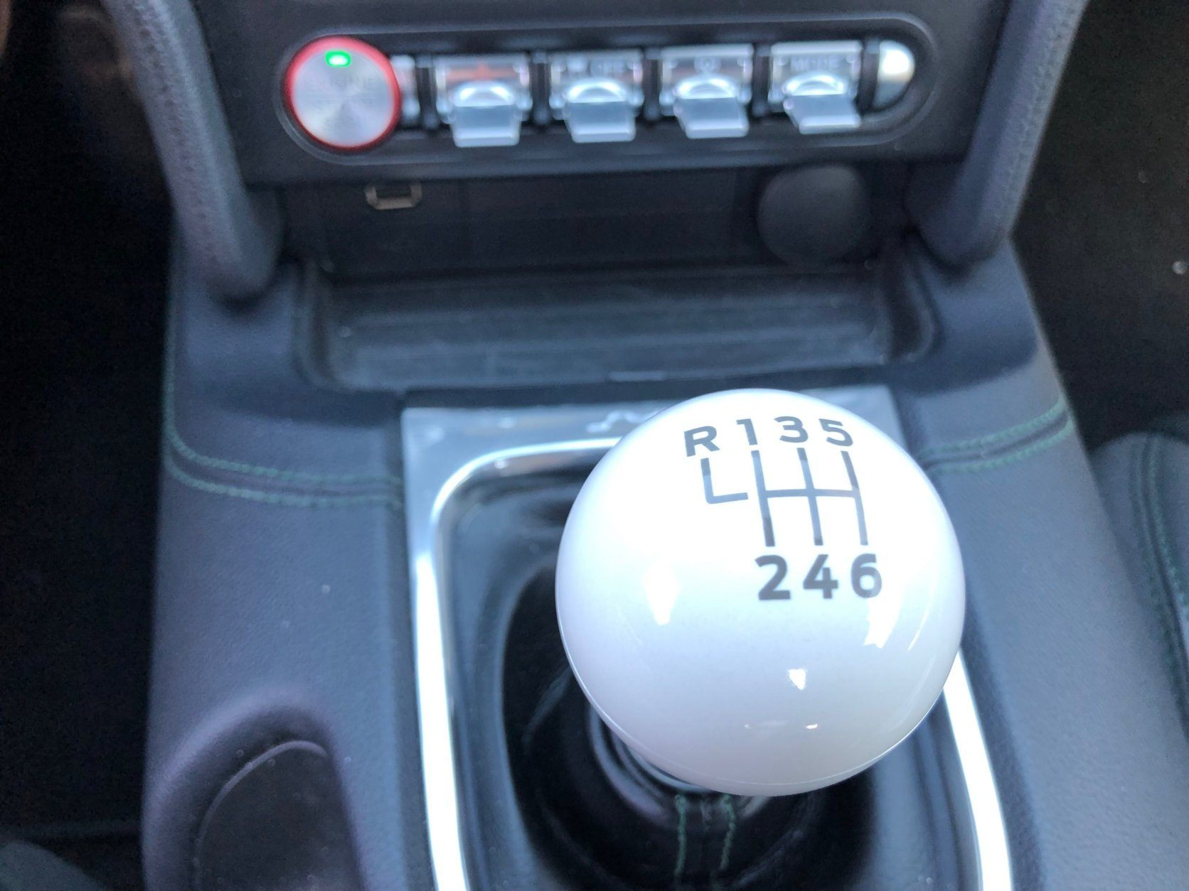 <p>The modern car's white cue ball shifter is a thing of simplistic beauty. Great exhaust rumble while driving. Highland Green paint sparkles in the sun thanks to blue, yellow, and silver metal flakes.</p>