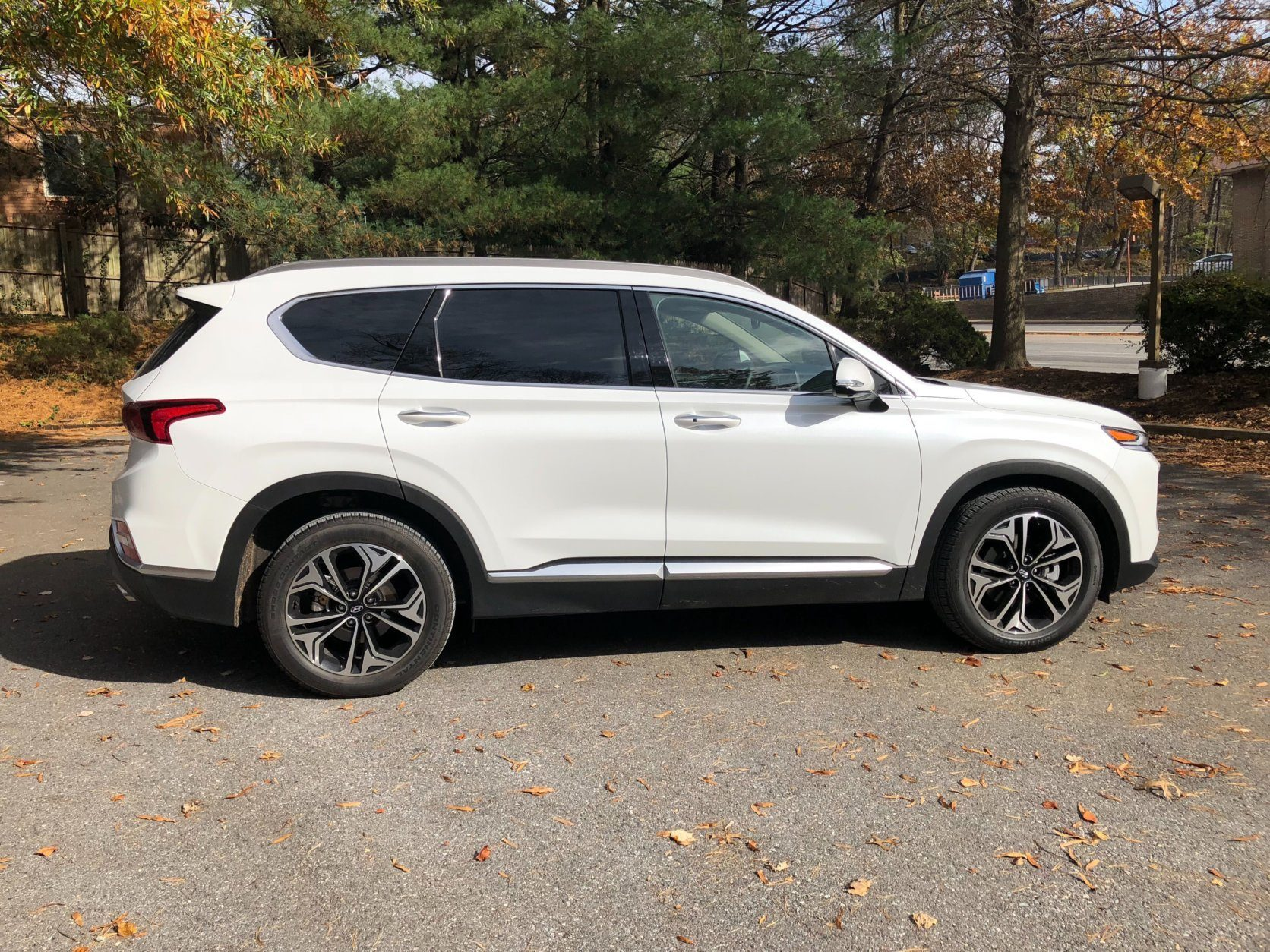 <p>Looking from the side, the Santa Fe reveals large 19-inch wheels that are a bit busy for some onlookers when I asked. No boring flat body here, cheat lines top and bottom add visual punch and hold your attention.</p> <p>The Quartz White Pearl paint on the Hyundai looks sharp. There are just enough black lower body moldings and bright trim pieces to make the color pop.</p>