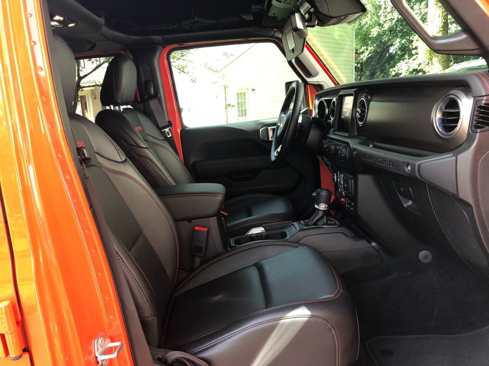 Leather seats and nicer interior materials. A big step up for the Wrangler.