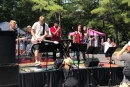 Kids perform at the Woodstock Anniversary Concert put on by School of Rock Columbia.