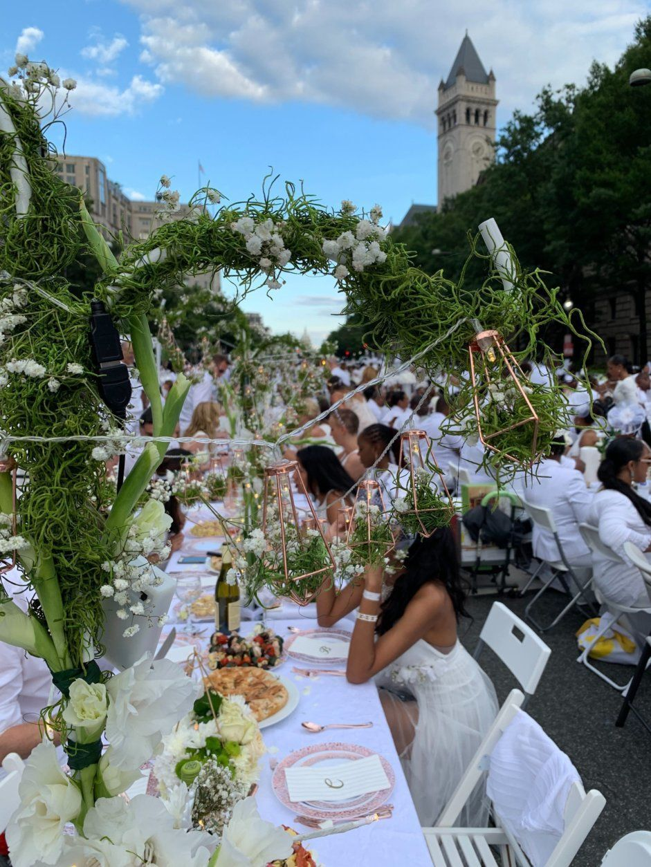 <p>As picnickers, who only found out the event&#8217;s location about an hour ahead of time, descended upon Pennsylvania Avenue from all directions starting around 5:30 Saturday evening, tourists and taxi drivers took notice. They asked partygoers about the occasion, and many stopped to take photos and gawk at thousands of people decked out in white.</p>