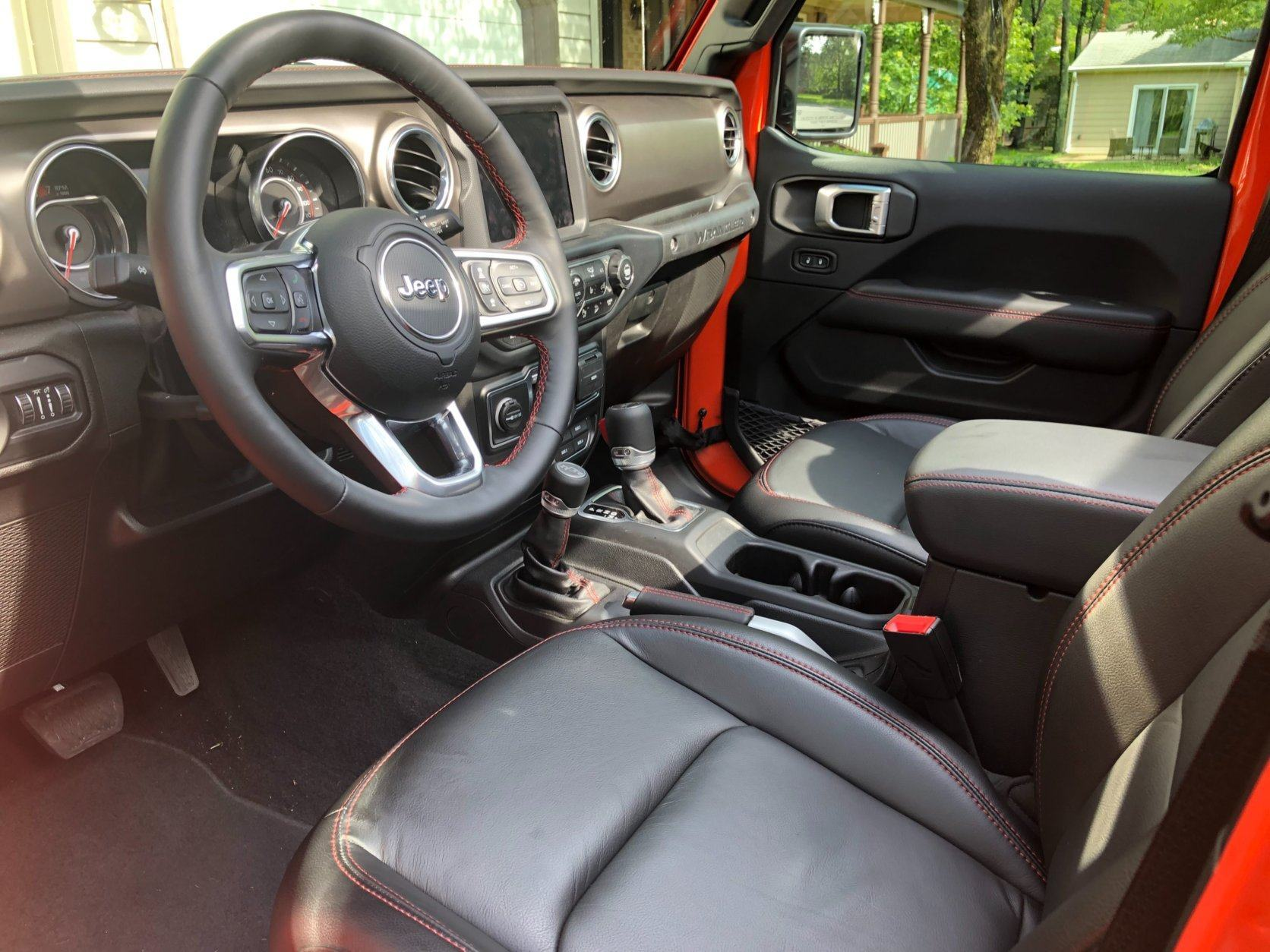 <p>The inside is also a nicer in 2019. Yes, much of that has to do with testing the Rubicon, one of the upper trim levels, with a price of $56,755 after nearly $15,000 in options. That extra cash buys you a nicer place to sit with leather seats, steering wheel, parking brake handle and shifter knob. Even the door panels are a higher quality. It would be a shame to get them muddy and dirty out on the trail.</p>