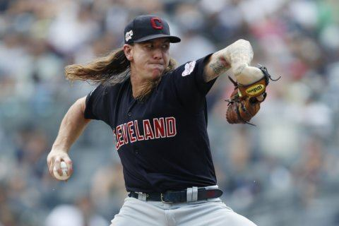 Clevinger fans 10, Indians tame Yankees 8-4 for 4-game split