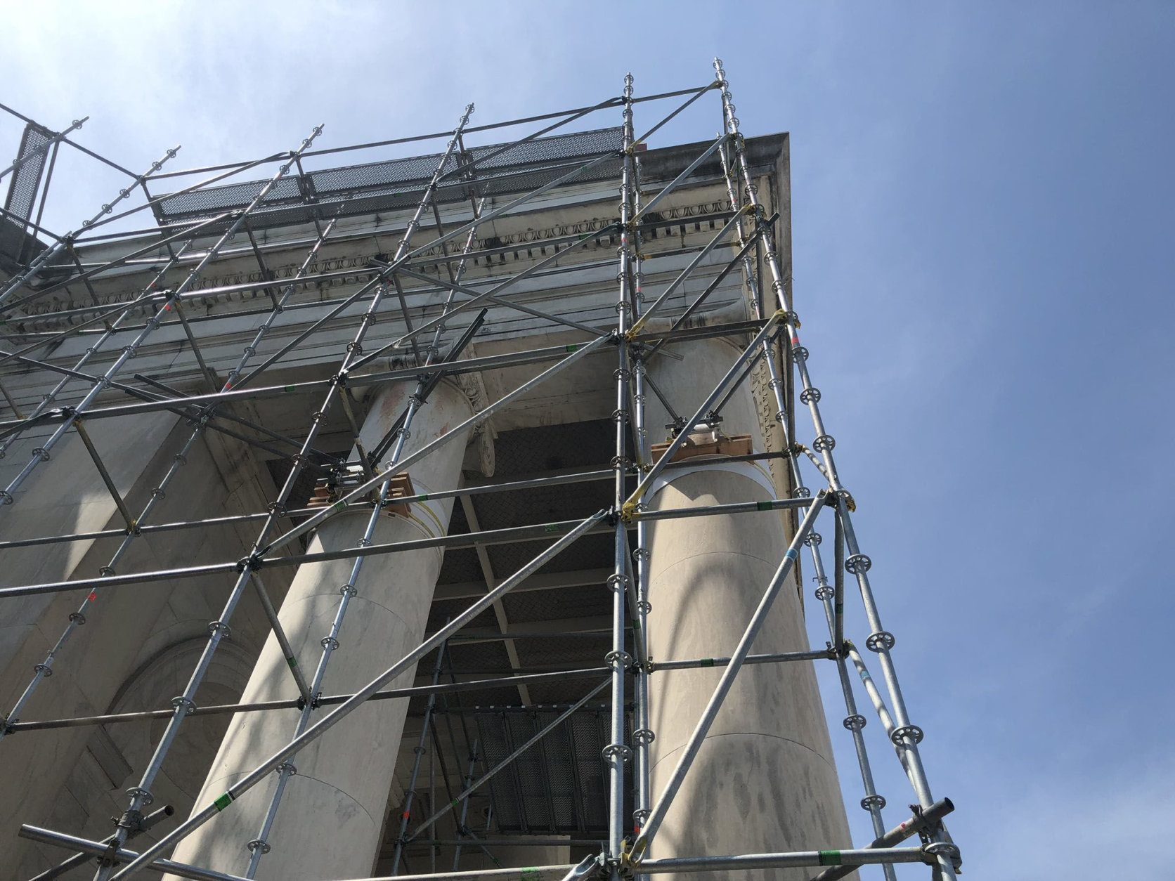 <p>Lower-tech restoration efforts on the monument present their own logistical challenges.</p> <p>A mechanical lift and maze of metal scaffolding stairways are used to move equipment, materials and workers more than 100 feet into the air to the memorial&#8217;s various levels that need attention. Water and electricity used for restoration work has to be delivered to elevated areas.</p>