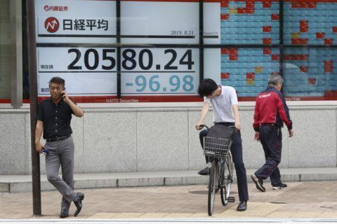 Global stocks mostly rise ahead of US Fed release