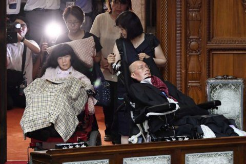 New emperor opens Japan's Diet, now wheelchair accessible