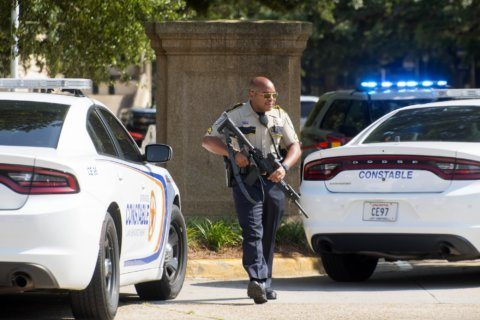 The Latest: LSU gives all-clear after armed intruder report
