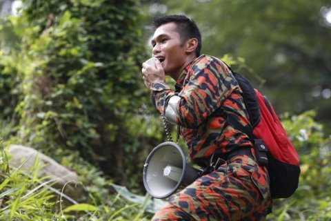 Mother's voice pierces Malaysia jungle in search for girl
