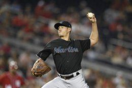 Miami Marlins relief pitcher Wei-Yin Chen, of Taiwan, delivers  during the fourth inning of a baseball game against the Washington Nationals, Saturday, Aug. 31, 2019, in Washington. (AP Photo/Nick Wass)
