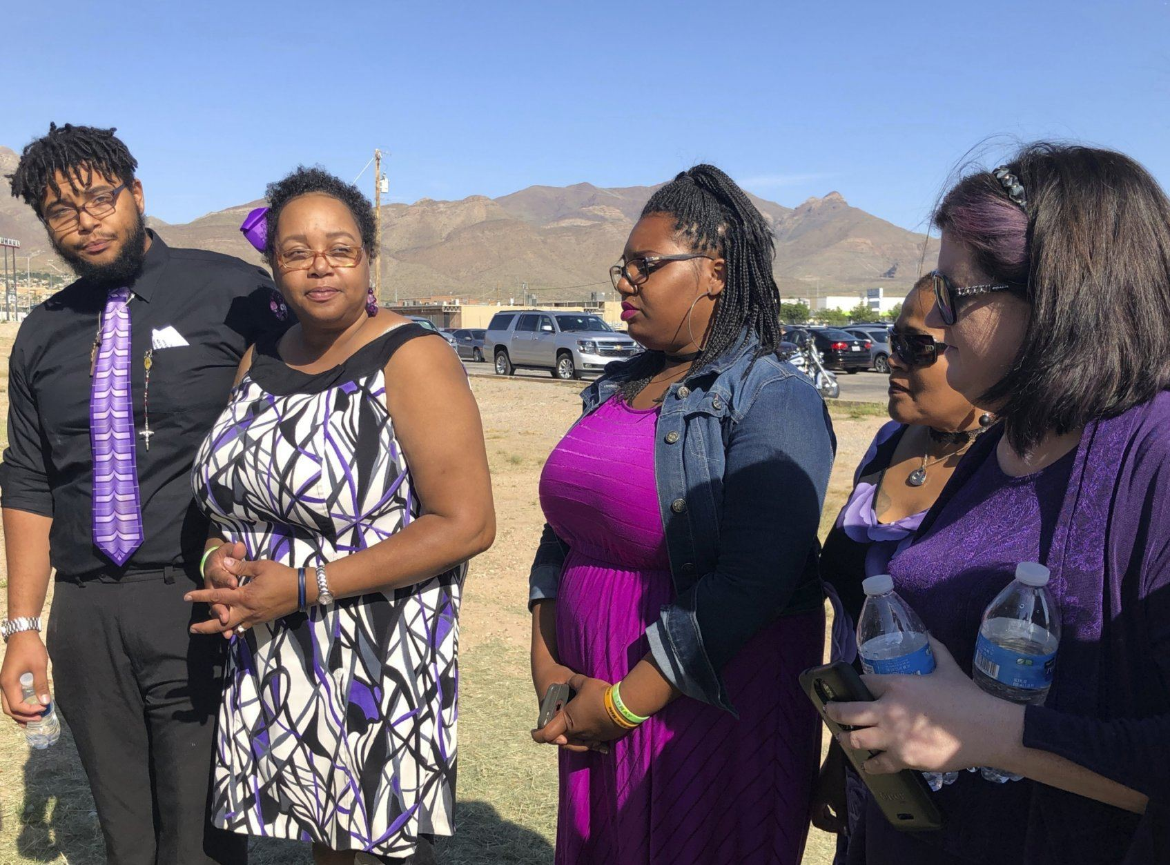 Tyler Reckard, left, 19, speaks to reporters on Saturday, Aug. 17, 2019, in El Paso, Texas, along side other family members about his grandmother, Margie Reckard, 63, before her funeral. Thousands of strangers from El Paso and around the country came to pay their respects this weekend to Reckard, who was killed by a gunman who opened fire at a Walmart in El Paso earlier this month.   (AP Photo/Russell Contreras)