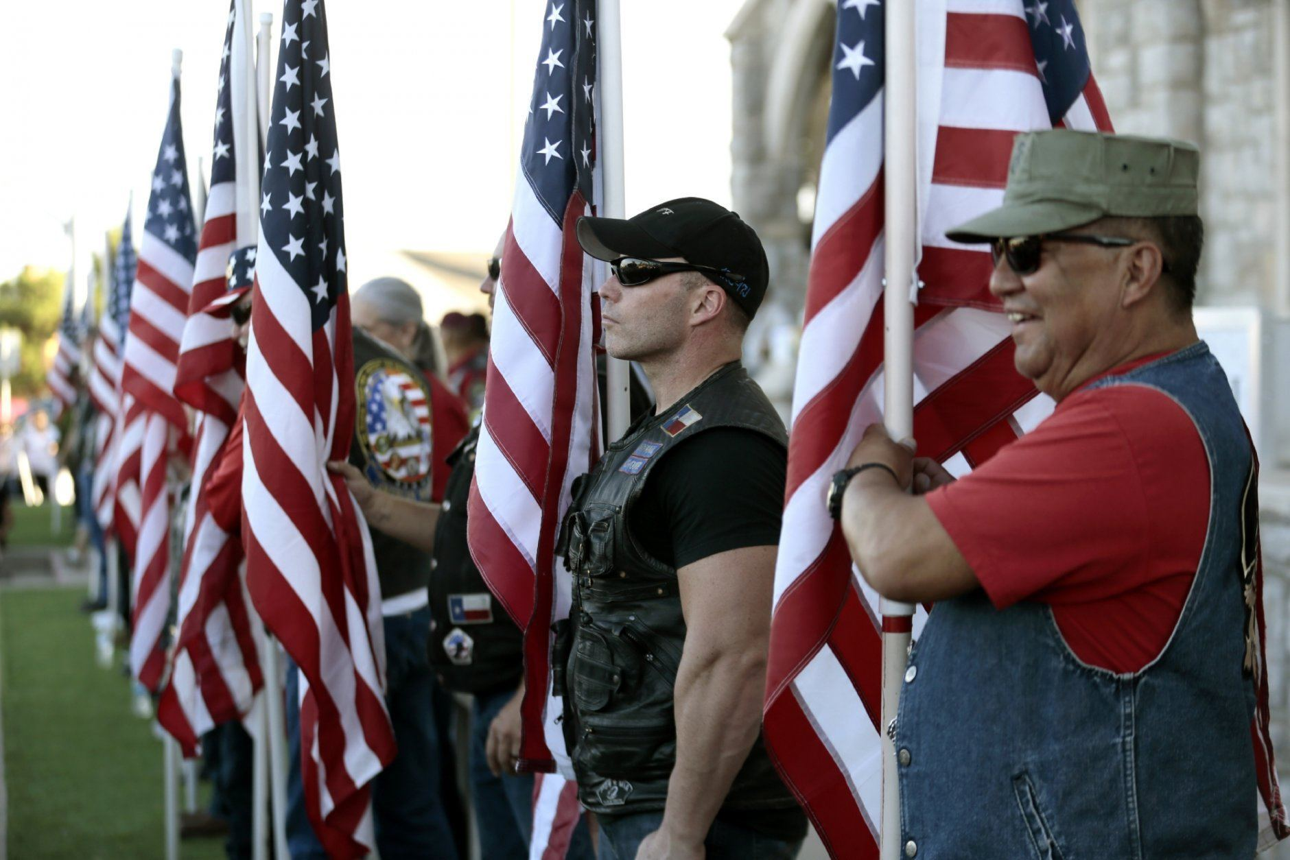 Veterans groups line the sidewalk outside Margie Reckard's funeral at La Paz Faith Memorial & Spiritual Center in El Paso, Texas Friday, Aug. 16, 2019. Without much family and friends in town, Antonio Basco invited the public to his longtime companion's funeral and El Paso showed up in droves. Reckard was among those killed in a mass shooting on Aug. 3. (Mark Lambie/The El Paso Times via AP)