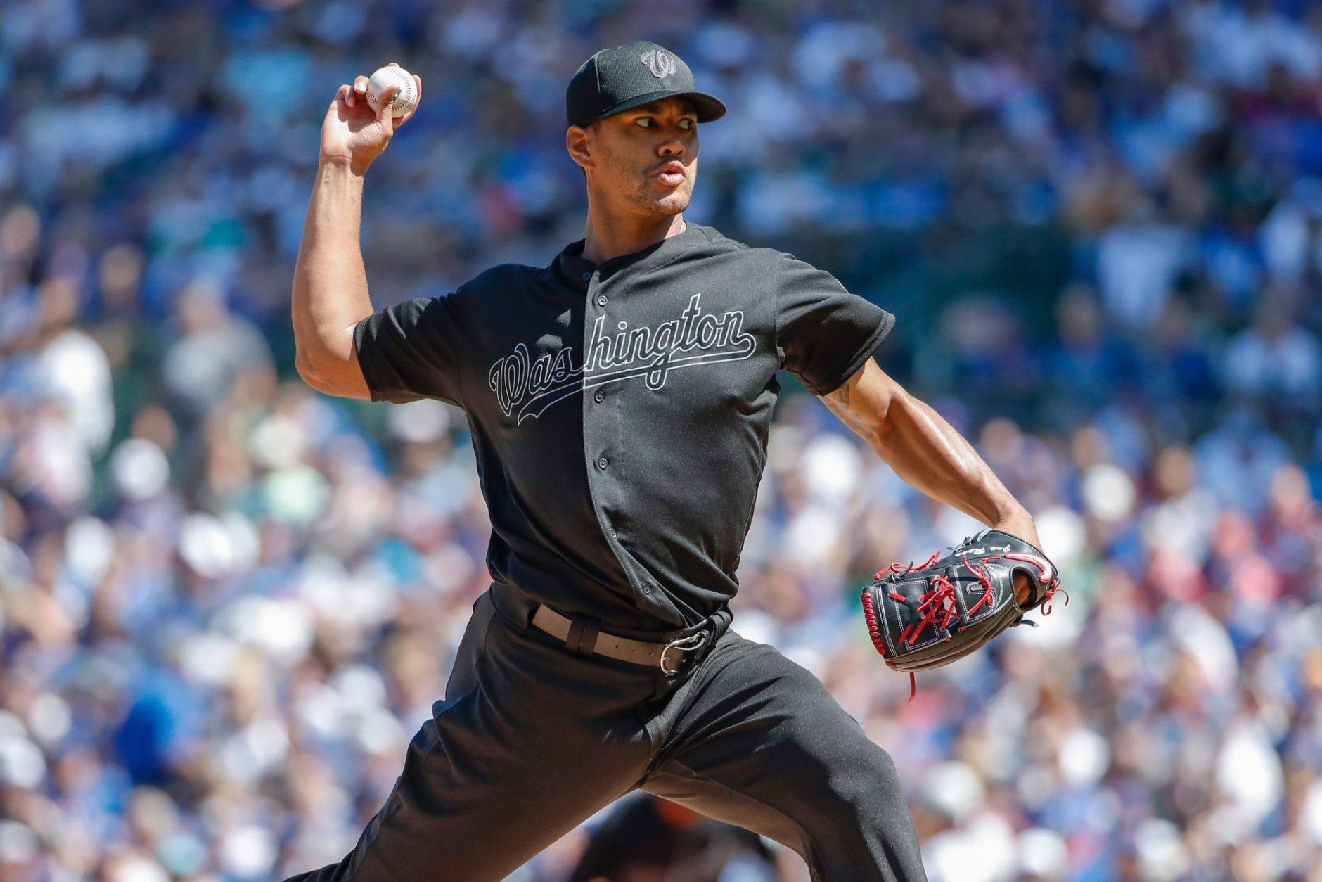 Washington Nationals starting pitcher Joe Ross delivers against the Chicago Cubs during the second inning of a baseball game, Saturday, Aug. 24, 2019, in Chicago. (AP Photo/Kamil Krzaczynski)