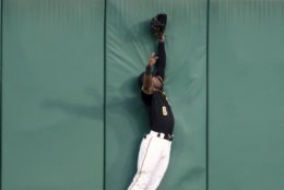 Pittsburgh Pirates center fielder Starling Marte leaps at the wall, but can't catch a three-run home run by Washington Nationals' Asdrubal Cabrera during the third inning of a baseball game Wednesday, Aug. 21, 2019, in Pittsburgh. (AP Photo/Keith Srakocic)