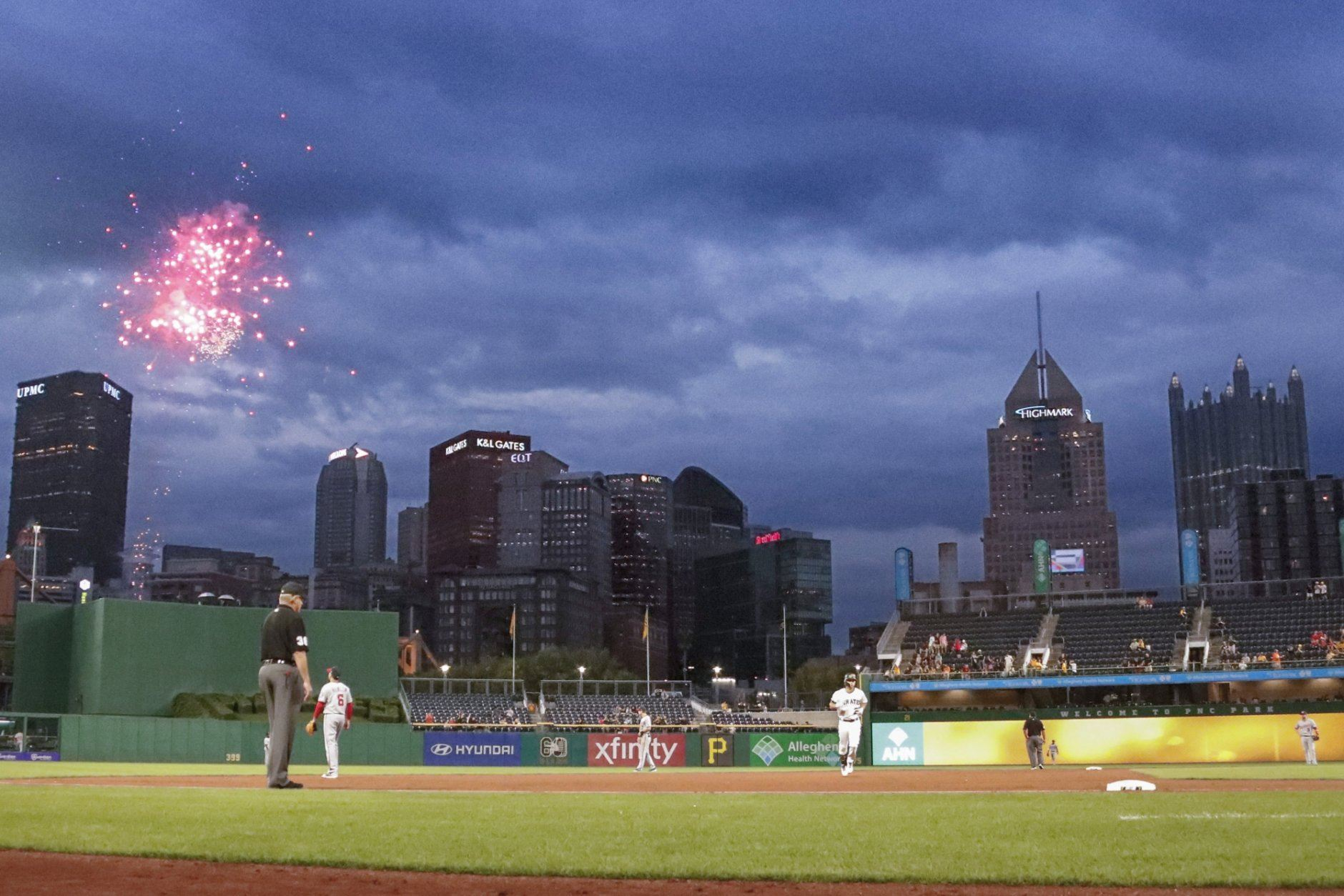 Fireworks explode as Pittsburgh Pirates Adam Frazier, center right, rounds second base after hitting a solo home run against the Washington Nationals in the third of a baseball game Thursday, Aug. 22, 2019, in Pittsburgh. (AP Photo/Keith Srakocic)