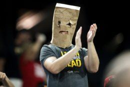 A Pittsburgh Pirates fan wears a paper bag over his head while applauding before the start of the seventh inning of a baseball game against the Washington Nationals, Monday, Aug. 19, 2019, in Pittsburgh. The Pirates were losing 11-0 at the time. (AP Photo/Keith Srakocic)