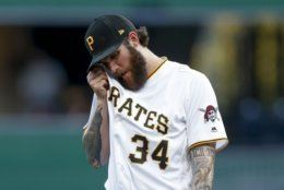 Pittsburgh Pirates starting pitcher Trevor Williams wipes his face after walking Washington Nationals' Juan Soto in the first inning of a baseball game, Monday, Aug. 19, 2019, in Pittsburgh. (AP Photo/Keith Srakocic)