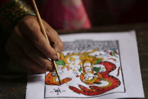 AP PHOTOS: Nepal's painter caste struggles to save dying art
