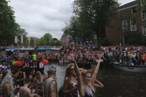 LGBT pride parade in Amsterdam features boats as floats