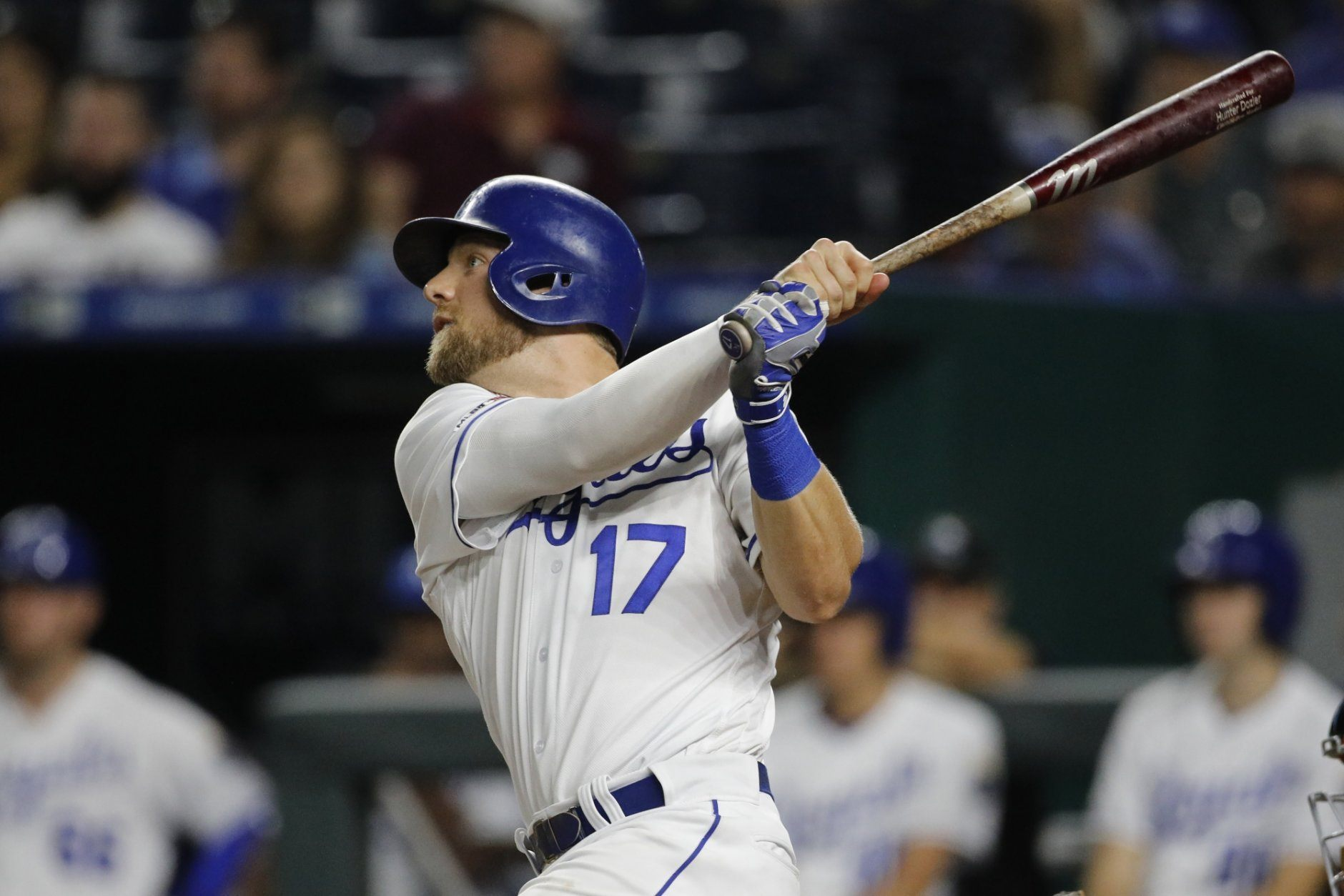 Kansas City Royals' Hunter Dozier hits a solo home run to tie the game in the seventh inning of a baseball game against the Baltimore Orioles at Kauffman Stadium in Kansas City, Mo., Saturday, Aug. 31, 2019. (AP Photo/Colin E. Braley)