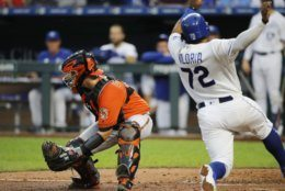 Kansas City Royals' Meibrys Viloria (72) scores as Baltimore Orioles catcher Chance Sisco (15) waits for a late throw in the fourth inning of a baseball game at Kauffman Stadium in Kansas City, Mo., Saturday, Aug. 31, 2019. (AP Photo/Colin E. Braley)