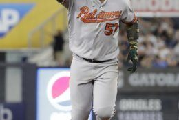 Baltimore Orioles' Hanser Alberto gestures to fans as he runs the bases after hitting a three-run home run during the seventh inning of the second game of a baseball doubleheader against the New York Yankees, Monday, Aug. 12, 2019, in New York. (AP Photo/Frank Franklin II)