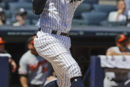New York Yankees' Didi Gregorius follows through on a three-run home run during the first inning of the first game of a baseball doubleheader against the Baltimore Orioles, Monday, Aug. 12, 2019, in New York. (AP Photo/Frank Franklin II)