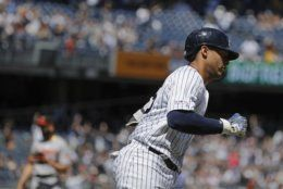 New York Yankees' Gleyber Torres runs the bases after hitting a home run during the first inning of the first game of a baseball doubleheader against the Baltimore Orioles Monday, Aug. 12, 2019, in New York. (AP Photo/Frank Franklin II)