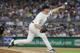 New York Yankees' Joe Mantiply delivers a pitch during the fourth inning of the second game of a baseball doubleheader against the Baltimore Orioles, Monday, Aug. 12, 2019, in New York. The Yankees won 11-8. (AP Photo/Frank Franklin II)