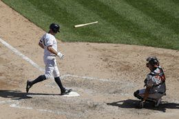 New York Yankees' Brett Gardner, left, reaches home plate on a sacrifice fly ball by Didi Gregorius during the seventh inning as Baltimore Orioles catcher Pedro Severino, right, watches in the first game of a baseball doubleheader Monday, Aug. 12, 2019, in New York. (AP Photo/Frank Franklin II)