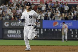 New York Yankees' Gleyber Torres runs the bases after hitting a three-run home run during the fifth inning of the second game of a baseball doubleheaderagainst the Baltimore Orioles, Monday, Aug. 12, 2019, in New York. (AP Photo/Frank Franklin II)