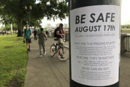 "A posted sign reads ""Be Safe. August 17th"" is posted in Portland, Ore., Saturday, Aug. 17, 2019.  Right-wing groups and counterprotesters gathered in downtown Portland, Oregon, on Saturday and authorities set up concrete barriers and closed streets in an effort to contain the groups. (AP Photo/Gillian Flaccus)"