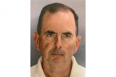 Priest accused of stealing nearly $100K from parish