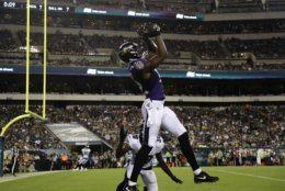 Baltimore Ravens' Jaleel Scott, top, catches a touchdown against Philadelphia Eagles' Jeremiah McKinnon (38) during the first half of a preseason NFL football game, Thursday, Aug. 22, 2019, in Philadelphia. (AP Photo/Michael Perez)