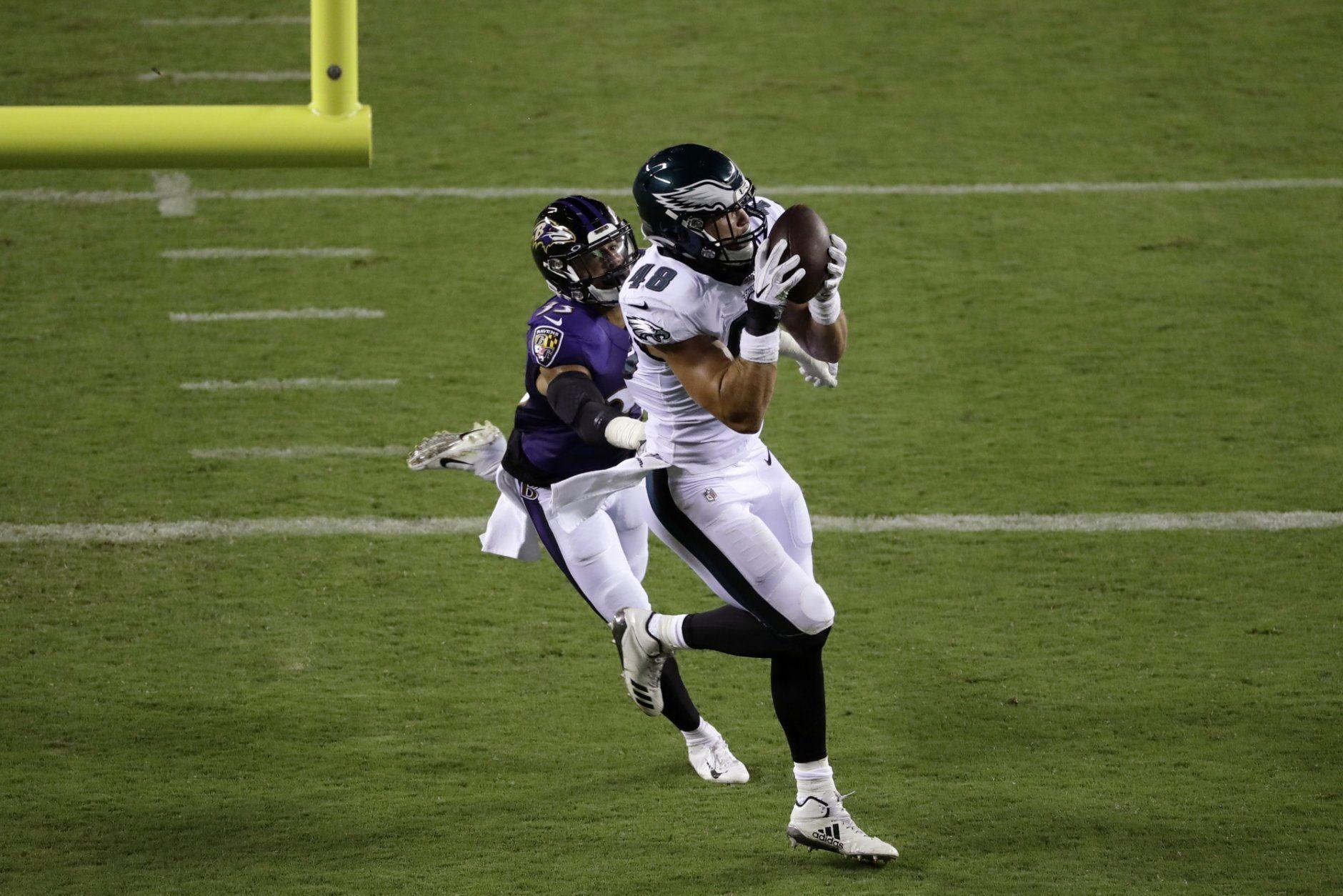Philadelphia Eagles' Alex Ellis, right, catches a touchdown pass against Baltimore Ravens' Bennett Jackson (33) during the second half of a preseason NFL football game Thursday, Aug. 22, 2019, in Philadelphia. (AP Photo/Michael Perez)