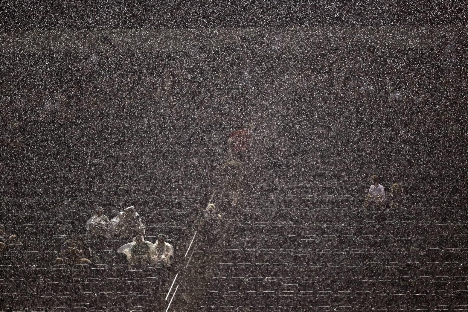 Rain pours down during the second half of a preseason NFL football game between the Philadelphia Eagles and the Baltimore Ravens, Thursday, Aug. 22, 2019, in Philadelphia. (AP Photo/Michael Perez)