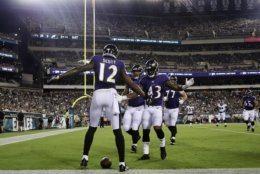 Baltimore Ravens' Jaleel Scott celebrates with teammates after scoring a touchdown during the first half of a preseason NFL football game against the Philadelphia Eagles, Thursday, Aug. 22, 2019, in Philadelphia. (AP Photo/Michael Perez)