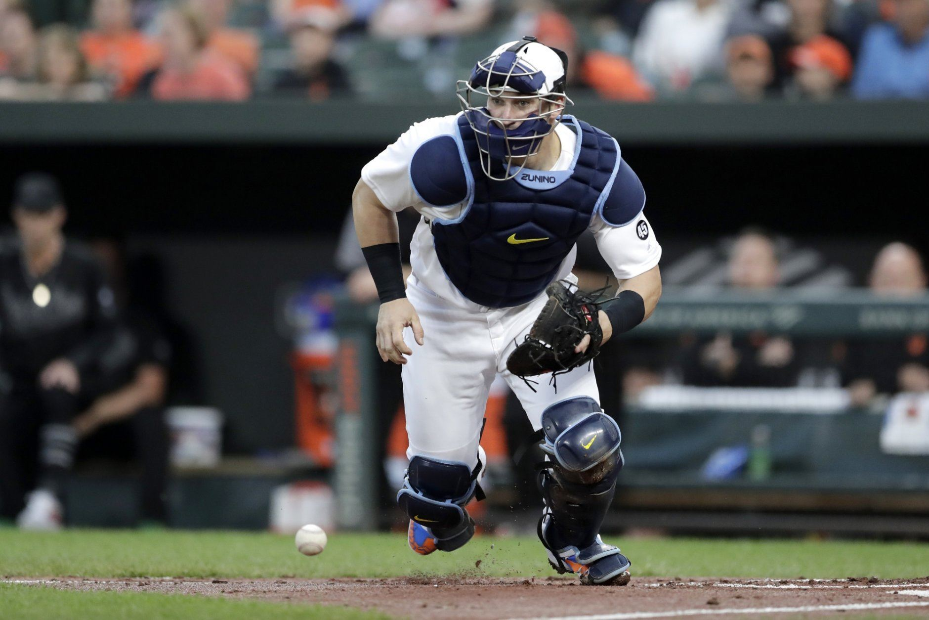 Tampa Bay Rays catcher Mike Zunino eyes Baltimore Orioles' Jonathan Villar on third base after blocking a throw from center fielder Kevin Kiermaier during the first inning of a baseball game, Friday, Aug. 23, 2019, in Baltimore. (AP Photo/Julio Cortez)