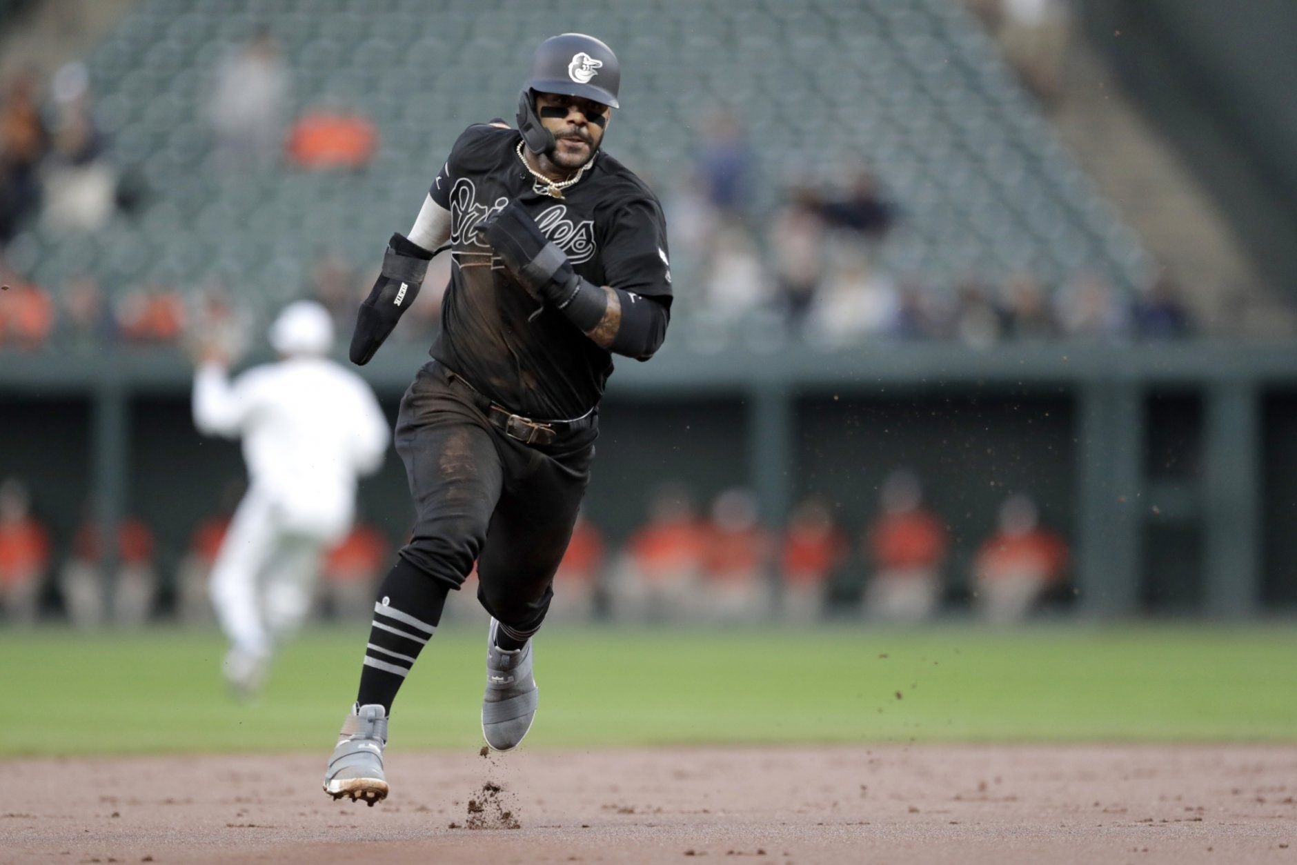 Baltimore Orioles' Jonathan Villar runs to third base on a double by Anthony Santander off Tampa Bay Rays starting pitcher Trevor Richards during the first inning of a baseball game, Friday, Aug. 23, 2019, in Baltimore. (AP Photo/Julio Cortez)