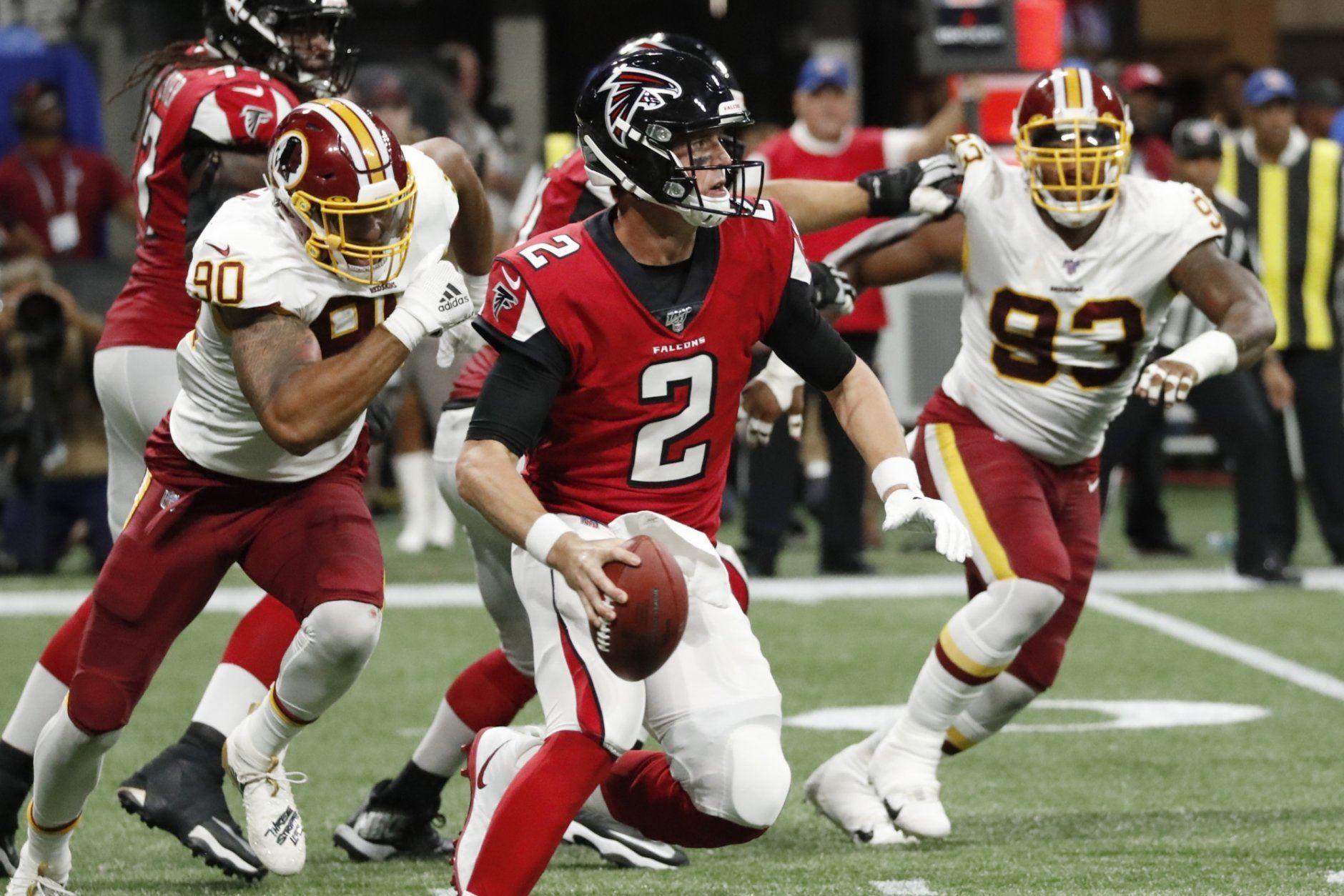 Atlanta Falcons quarterback Matt Ryan (2) runs out of the pocket against the Washington Redskins during the first half an NFL preseason football game, Thursday, Aug. 22, 2019, in Atlanta. (AP Photo/John Bazemore)