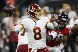 Washington Redskins quarterback Case Keenum (8) works in the pocket against the Atlanta Falcons during the first half an NFL preseason football game, Thursday, Aug. 22, 2019, in Atlanta. (AP Photo/John Bazemore)