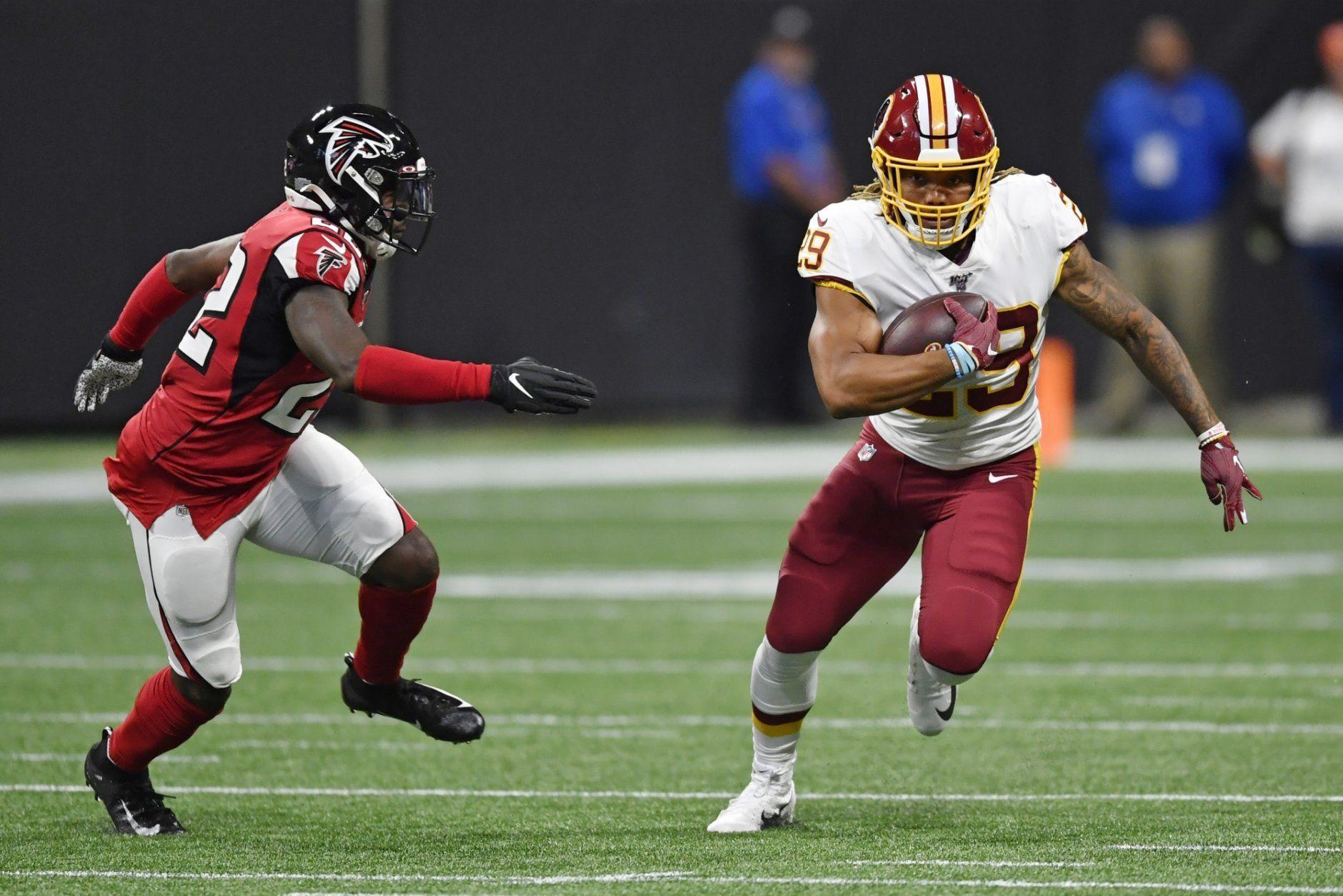 Washington Redskins running back Derrius Guice (29) runs against the Atlanta Falcons during the first half an NFL preseason football game, Thursday, Aug. 22, 2019, in Atlanta. (AP Photo/Mike Stewart)