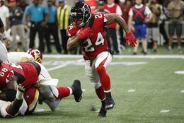 Atlanta Falcons running back Devonta Freeman (24) runs out of the backfield against the Washington Redskins during the first half an NFL preseason football game, Thursday, Aug. 22, 2019, in Atlanta. (AP Photo/John Bazemore)