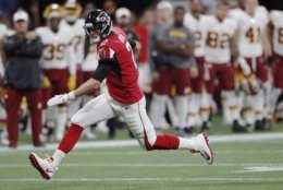 Atlanta Falcons quarterback Matt Ryan (2) runs against the Washington Redskins during the first half an NFL preseason football game, Thursday, Aug. 22, 2019, in Atlanta. (AP Photo/John Bazemore)