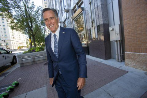 Romney says climate change happening, humans contribute