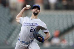 Kansas City Royals starting pitcher Jorge Lopez throws a pitch to a Baltimore Orioles batter during the first inning of a baseball game, Monday, Aug. 19, 2019, in Baltimore. (AP Photo/Julio Cortez)