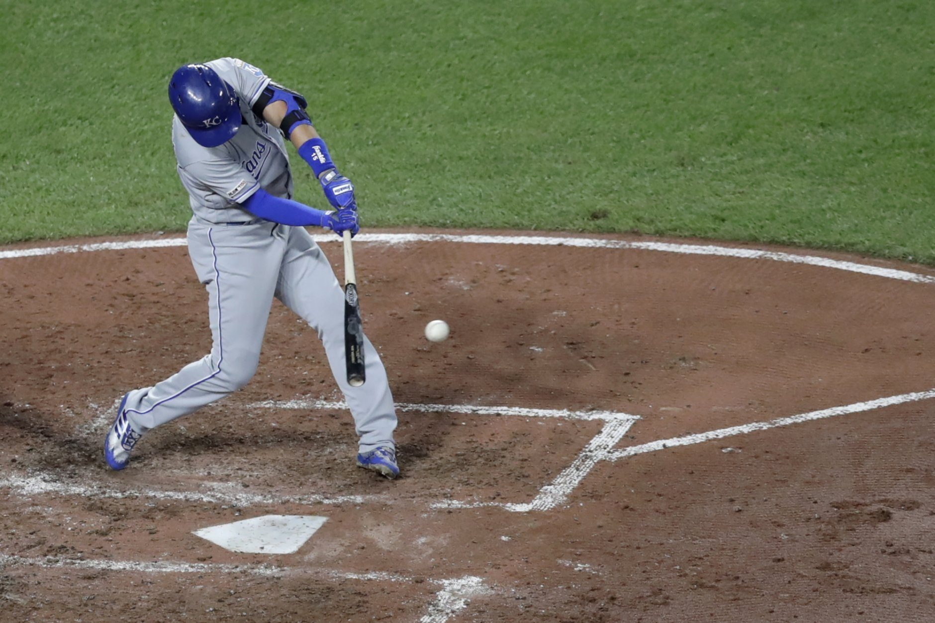 Kansas City Royals' Whit Merrifield singles off Baltimore Orioles starting pitcher John Means, not visible, during the sixth inning of a baseball game, Monday, Aug. 19, 2019, in Baltimore. Royals' Nicky Lopez scored on the play. (AP Photo/Julio Cortez)