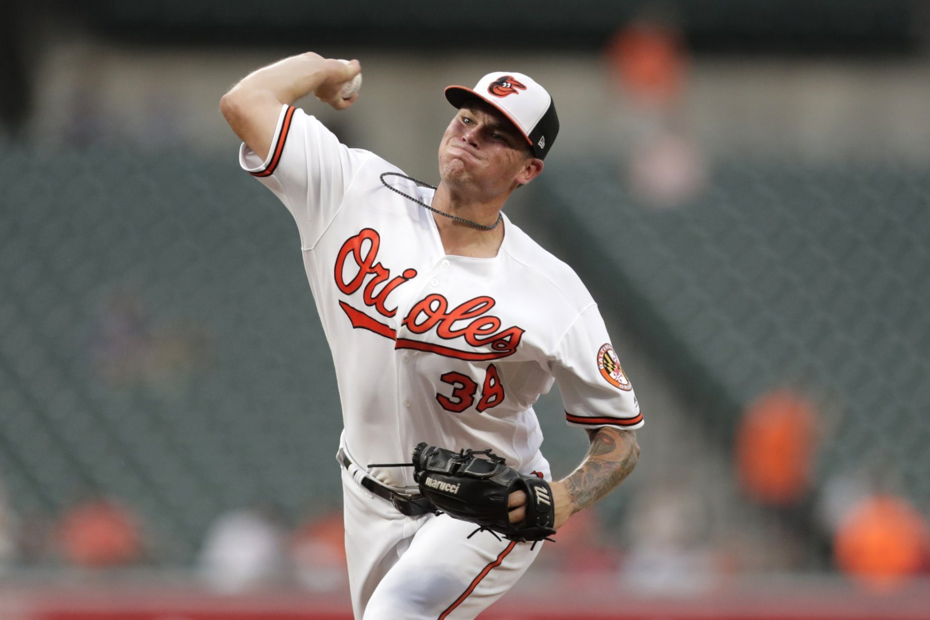 Baltimore Orioles starting pitcher Aaron Brooks throws to a Kansas City Royals batter during the second inning of a baseball game, Wednesday, Aug. 21, 2019, in Baltimore. (AP Photo/Julio Cortez)