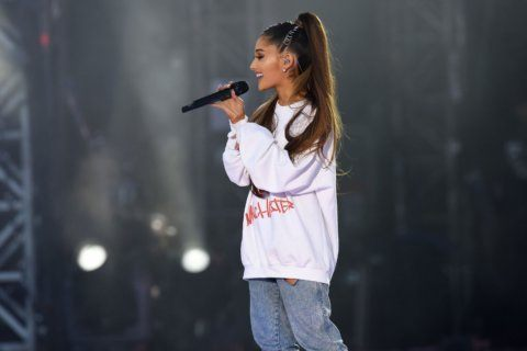 Ariana Grande says she's 'completely overwhelmed' in emotional return to Manchester