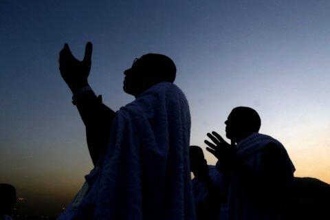 Muslim hajj pilgrims ascend Mount Arafat for day of worship