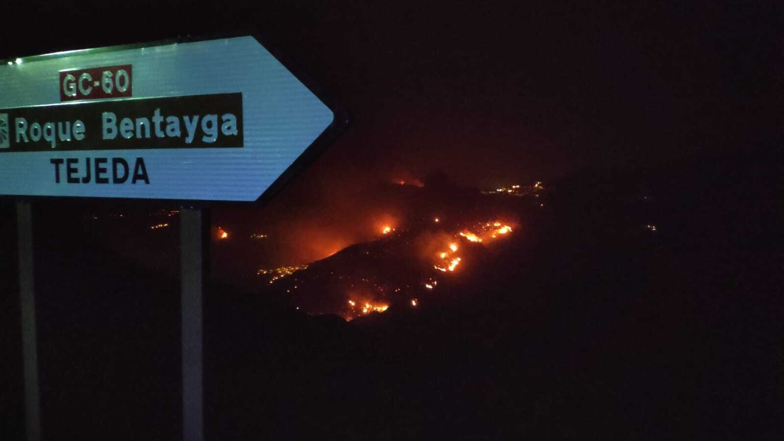 <p>In this photo issued by Cabildo de Gran Canaria, flames from a forest fire burn in Tejada, on the Spanish Gran Canaria island on Tuesday Aug. 20, 2019. The wind dropped overnight in the Canary Islands, allowing firefighters to make progress Tuesday against Spain&#8217;s biggest wildfire so far this year. More than 12,000 hectares (30,000 acres) have been charred on the western slopes of Gran Canaria, an island off northwest Africa. (Cabildo de Gran Canaria Via AP)</p>